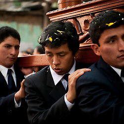 Men carry an image of the Virgin Mary during a Holy Week procession in Ayacucho, Peru.
