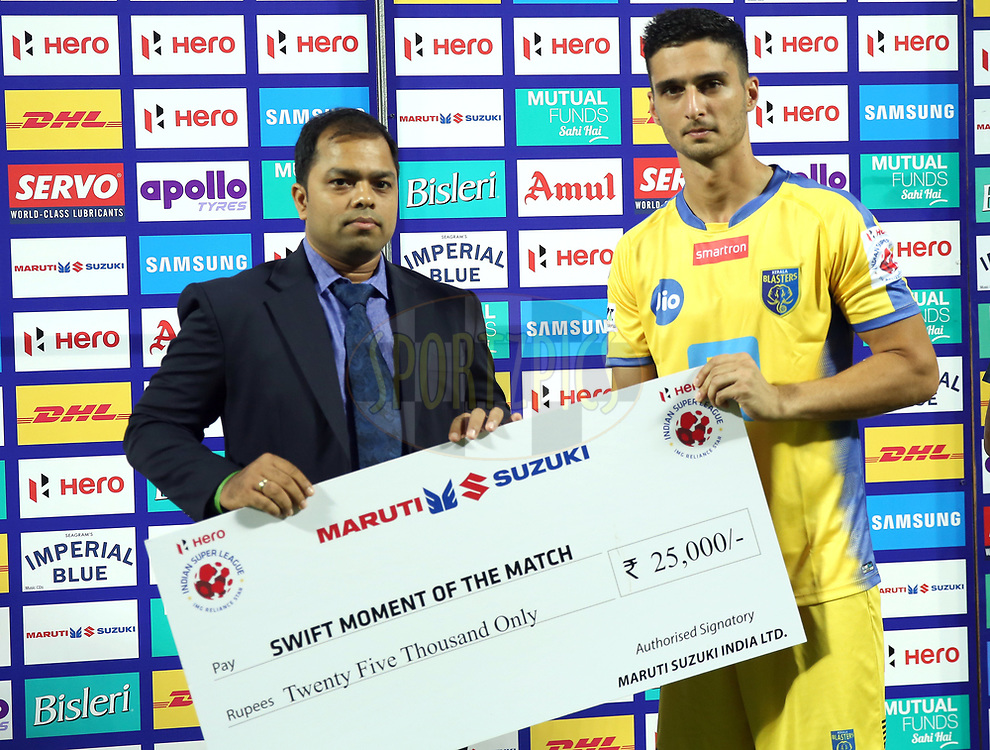 Karan Sawhney of Kerala Blasters FC  receives Swift momment of the match award during the presentation of the match 54 of the Hero Indian Super League between Kerala Blasters FC and FC Goa  held at the Jawaharlal Nehru Stadium,Kochi India on the 21st January 2018<br /> <br /> Photo by: Sandeep Shetty  / ISL / SPORTZPICS
