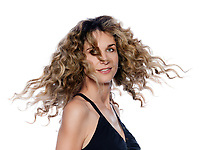 beautiful caucasian woman move curly hair smiling portrait isolated studio on white background