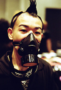 Man with a Mohican wearing a gas mask, Japan, 2003