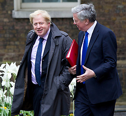 © Licensed to London News Pictures. 24/05/2013. London, UK. Boris Johnson, the Mayor of London, (Left) and Minister of State for Energy, Michael Fallon (right) arriving on Downing Street in London on 24/05/2013 where a meeting of the Olympic Legacy Committee chaired by the British Prime Minister David Cameron is due to take place. Photo credit: Matt Cetti-Roberts/LNP