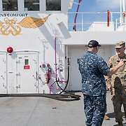 WEDNESDAY, OCTOBER 4- 2017--- - SAN JUAN, PUERTO RICO - <br /> US ARMY Brigadier General Richard Kim, right, gets a tour of the US Naval Hospital Ship Comfort at the Port of San Juan where it started treating patients affected by Hurricane Maria.<br /> (Photo by Angel Valentin for NPR)