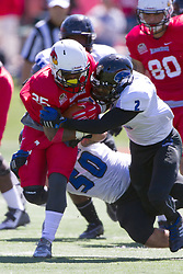 13 September 2014:  Adam Gristick and Jourdan Wickliffe(DB) work to bring a stop to a run by Marshaun Coprich during an NCAA football game between the Eastern Illinois Panthers and the Illinois State Redbirds at Hancock Stadium in Normal IL