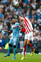 Fernandinho of Manchester City and Peter Crouch of Stoke compete in the air - Photo mandatory by-line: Rogan Thomson/JMP - 07966 386802 - 30/08/2014 - SPORT - FOOTBALL - Manchester, England - Etihad Stadium - Manchester City v Stoke City - Barclays Premier League.