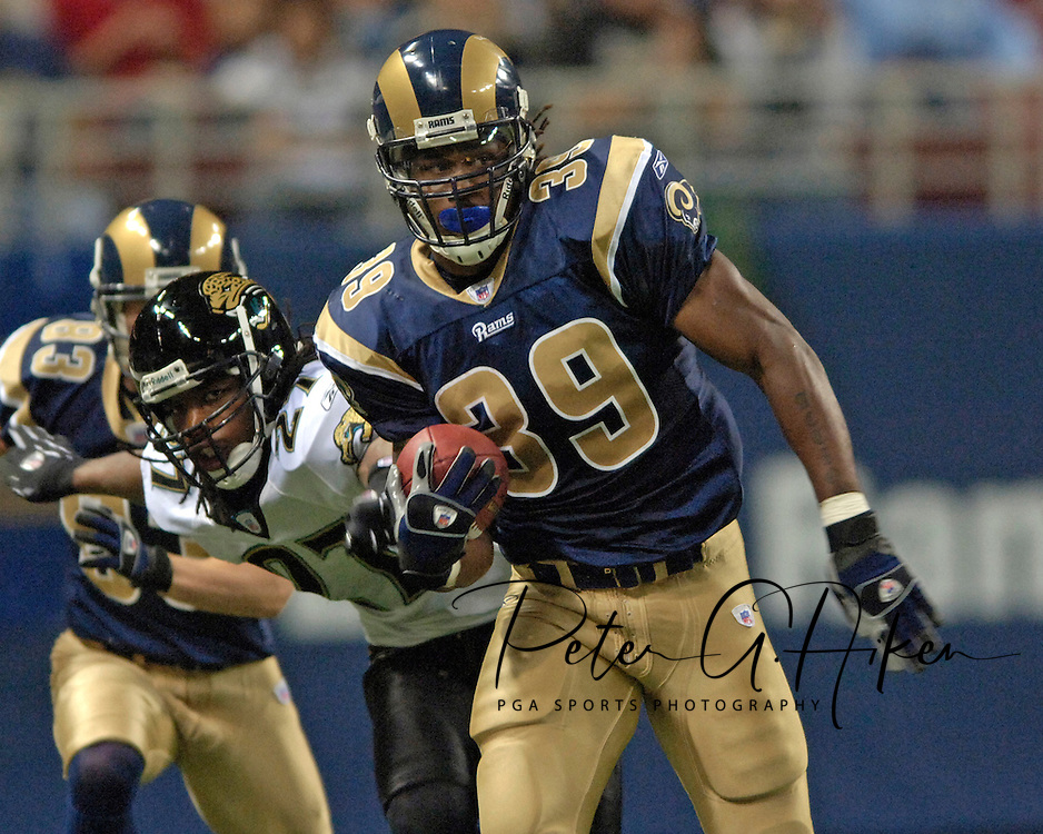 St. Louis Rams running back Steven Jackson (39) rushes past Jacksonville defensive back Rashean Mathis (27) in the third quarter at the Edward Jones Dome in St. Louis, Missouri, October 30, 2005.  The Rams beat the Jaguars 24-21.