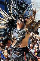 """Tlakatekolotl Nava (Man Owl) during a performance on September 9th, 2012 at Fiesta del Mar at the Monterey Bay Aquarium. By teaching their children traditional dances and conduct, members of the Yaocuauhtli - Eagle Warrior """"calpulli,"""" or group, are preserving a proud ethnic heritage."""