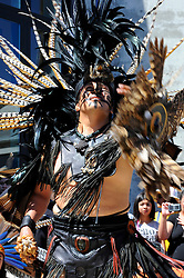 "Tlakatekolotl Nava (Man Owl) during a performance on September 9th, 2012 at Fiesta del Mar at the Monterey Bay Aquarium. By teaching their children traditional dances and conduct, members of the Yaocuauhtli - Eagle Warrior ""calpulli,"" or group, are preserving a proud ethnic heritage."