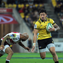Lionel Mapoe tries to tackle Ben Lam during the Super Rugby match between the Hurricanes and Lions at Westpac Stadium in Wellington, New Zealand on Saturday, 5 May 2018. Photo: Dave Lintott / lintottphoto.co.nz