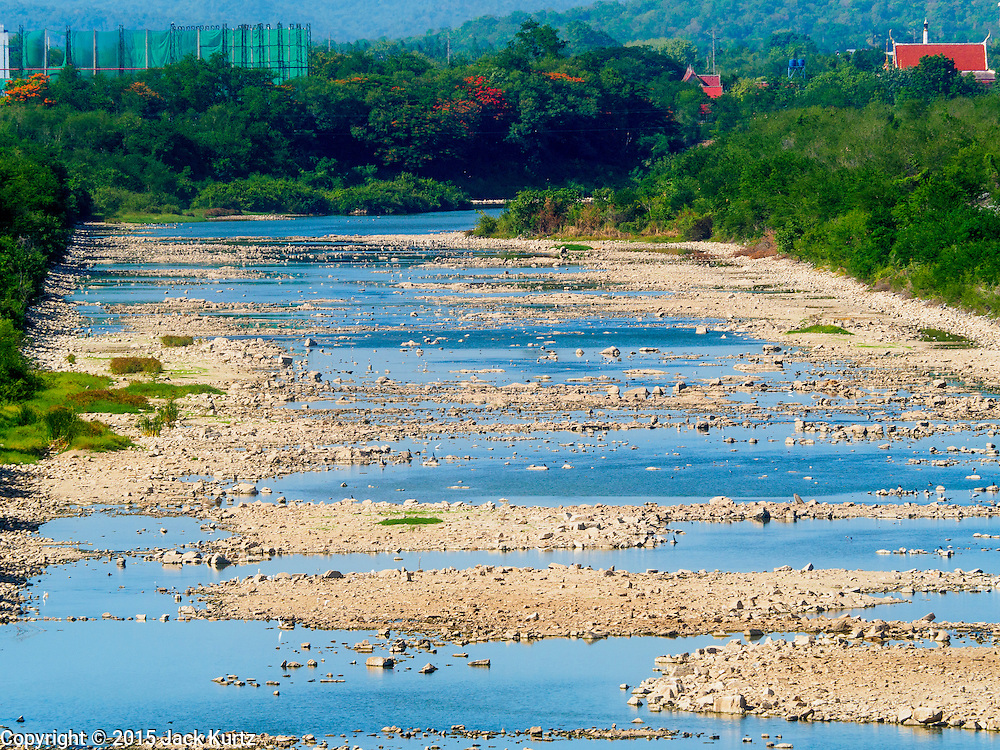 01 JULY 2015 - NONG BUA, LOPBURI, THAILAND:  The main irrigation canal flowing out Pa Sak Dam is dry. Normally it's completely full at this time of year. Central Thailand is contending with drought. By one estimate, about 80 percent of Thailand's agricultural land is in drought like conditions and farmers have been told to stop planting new acreage of rice, the area's principal cash crop. Water in reservoirs are below 10 percent of their capacity, a record low. Water in some reservoirs is so low, water no longer flows through the slipways and instead has to be pumped out of the reservoir into irrigation canals. Farmers who have planted their rice crops are pumping water out of the irrigation canals in effort to save their crops. Homes have collapsed in some communities on the Chao Phraya River, the main water source for central Thailand, because water levels are so low the now exposed embankment is collapsing. This is normally the start of the rainy season, but so far there hasn't been any significant rain.    PHOTO BY JACK KURTZ
