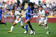 Everton's Marouane Fellaini © goes past Swansea's Jonathan De Guzman (l) and Angel Rangel (22). Barclays Premier league, Swansea city v Everton at the Liberty stadium in Swansea, South Wales on Sat 22nd Sept 2012.   pic by  Andrew Orchard, Andrew Orchard sports photography,