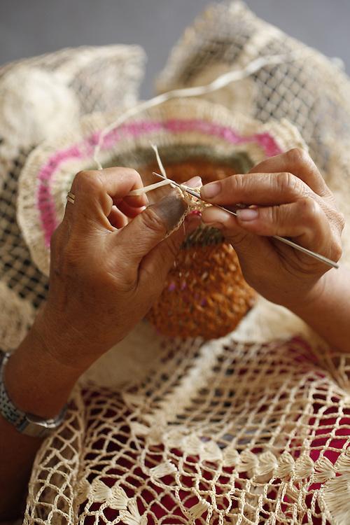 Barreirinhas_MA, Brasil.<br /> <br /> Processo de fabricao de artesanato de buriti no povoado de Marcelino. Na foto, artesa trabalha a fibra do Buriti usando um tear e a tecnica de Croche.<br /> <br /> The manufacture of handicrafts process in the Buriti Marcelino Village. <br /> In the photo, artisan works Buriti fiber using a loom and crochet technique.<br /> <br /> Foto: LEO DRUMOND / NITRO