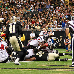 August 25, 2012; New Orleans, LA, USA; Houston Texans running back Ben Tate (44) pushes through the pile for a touchdown against the New Orleans Saints during the first quarter of a preseason game at the Mercedes-Benz Superdome. Mandatory Credit: Derick E. Hingle-US PRESSWIRE