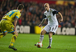 SWANSEA, WALES - Thursday, February 20, 2014: Swansea City's Jonjo Shelvey in action against SSC Napoli during the UEFA Europa League Round of 32 1st Leg match at the Liberty Stadium. (Pic by David Rawcliffe/Propaganda)