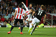 Nottingham Forest striker, on loan from Benfica, Hildeberto Pereira (17)  battles for possession with Brentford midfielder Ryan Woods (15)  during the EFL Sky Bet Championship match between Brentford and Nottingham Forest at Griffin Park, London, England on 16 August 2016. Photo by Matthew Redman.