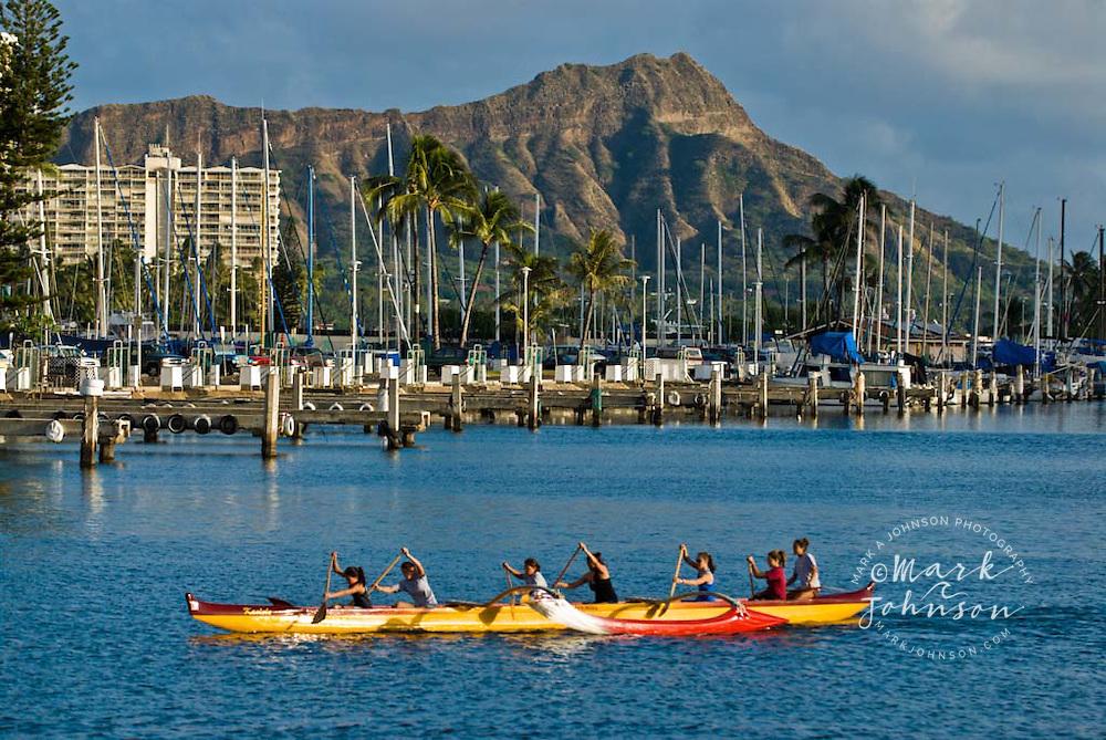 Outrigger canoe paddlers, Diamond Head in bg, Waikiki, Oahu, Hawaii