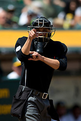 OAKLAND, CA - APRIL 09:  MLB umpire Adam Hamari #78 calls a strike during the fourth inning between the Oakland Athletics and the Texas Rangers at O.co Coliseum on April 9, 2015 in Oakland, California. The Texas Rangers defeated the Oakland Athletics 10-1. (Photo by Jason O. Watson/Getty Images) *** Local Caption *** Adam Hamari