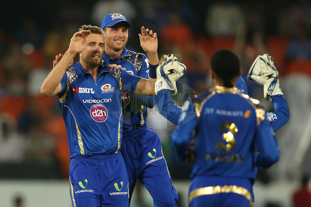 Tim Southee of Mumbai Indians is congratulated by Jos Buttler of Mumbai Indians and Parthiv Patel of Mumbai Indians (unsighted) during match 12 of the Vivo IPL 2016 (Indian Premier League) between the Sunrisers Hyderabad and the Mumbai Indians held at the Rajiv Gandhi Intl. Cricket Stadium, Hyderabad on the 18th April 2016<br /> <br /> Photo by Shaun Roy/ IPL/ SPORTZPICS