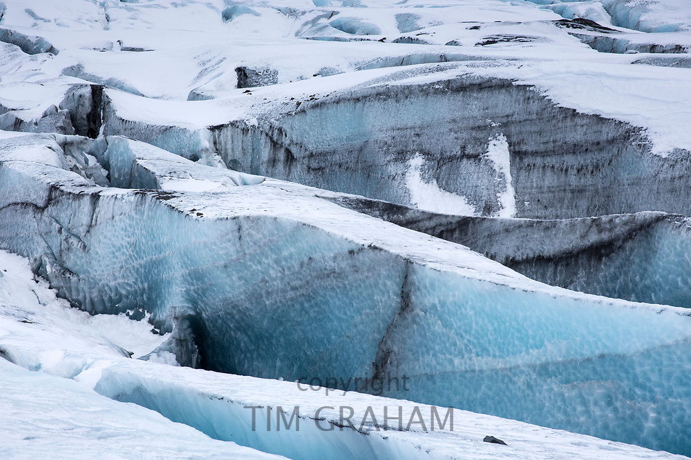 Close up showing layers in ice blocks in glacial tongue of Svinafellsjokull glacier an outlet glacier of Vatnajokull, South Iceland
