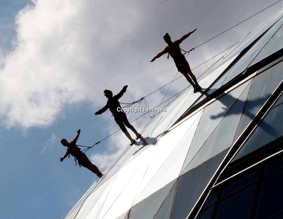 Members of the Streb extreme action dancers 'sky walk' down City Hall in London, Sunday, 15th July 2012  Photo by Andre Camara /  i-Images