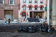 Black refuse garbage bags pile up after severe snow along South Side Street, Lower Manhattan, New York City, New York, United States of America.  (photo by Andrew Aitchison / In pictures via Getty Images)