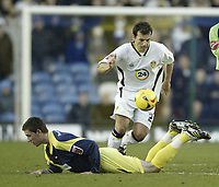 Photo: Aidan Ellis.<br /> Leeds United v Derby County. Coca Cola Championship. 09/12/2006.<br /> Leeds Robbie Blake chips the ball Over Derby's David Jones