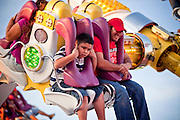 Oct. 21, 2009 -- PHOENIX, AZ: People on a ride on the midway at the Arizona State Fair in Phoenix, AZ. The fair runs through November 8.   Photo by Jack Kurtz