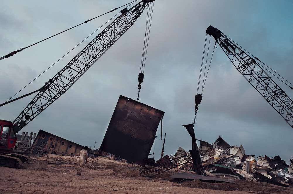 Men undertake demolition of a ship at the Gadani ship breaking yard, Balochistan Province, Pakistan on August 16, 2011.