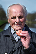 portrait of senior 88 year old man with dentures in his hands