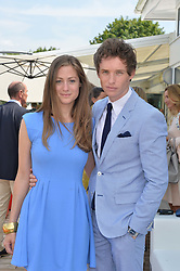 EDDIE REDMAYNE and HANNAH BAGSHAWE at the Audi International Polo at Guards Polo Club, Windsor Great Park, Egham, Surrey on 26th July 2014.