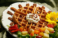 KEVIN BARTRAM/The Daily News.A pecan waffle topped with pecan butter is shown at the Queen's Crazy Kitchen in League City on Monday, Oct. 31, 2005.