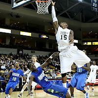 David Diakite (15) of the University of Central Florida Knights mens basketball team drives to the basket against Jamel Brazeal (4) of the West Florida Argonauts in the first home game of the 2010 season at the UCF Arena on November 12, 2010 in Orlando, Florida. UCF won the game 115-61. (AP Photo/Alex Menendez)