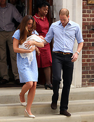 The Duke and Duchess of Cambridge and their baby boy George Alexander Louis leaving St Mary's hospital in London, UK. 23/07/2013<br />