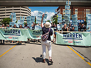09 JUNE 2019 - CEDAR RAPIDS, IOWA: Elizabeth Warren supporters block a street in front of the Cedar Rapids Convention Center before the Iowa Democrats 2019 Hall of Fame Celebration in the Cedar Rapids Convention Center. Nineteen of the Democratic candidates for president in 2020 spoke at the annual event. Iowa traditionally hosts the the first election event of the presidential election cycle. The Iowa Caucuses will be on Feb. 3, 2020.                          PHOTO BY JACK KURTZ