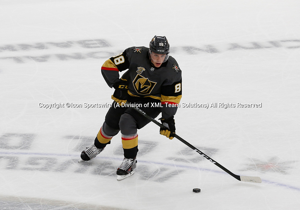 LAS VEGAS, NV - APRIL 11: Vegas Golden Knights defenseman Nate Schmidt (88) moves the puck during Game One of the Western Conference First Round of the 2018 NHL Stanley Cup Playoffs between the L.A. Kings and the Vegas Golden Knights Wednesday, April 11, 2018, at T-Mobile Arena in Las Vegas, Nevada. The Golden Knights won 1-0.  (Photo by: Marc Sanchez/Icon Sportswire)