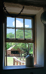 View of blacksmith shed from kitchen window, stoneware demi-John jug in foreground.<br />  Sauer-Beckman Living History Farm, LBJ State Park and Historic Site, Stonewall, TX