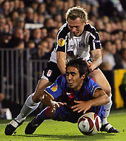 Fulham FC vs FC Basel UEFA Europa League 01/10/09<br /> Photo Nicky Hayes Fotosports International<br /> Fulham's Bjorn Helga Riise tangles with Marcos Gelabert.