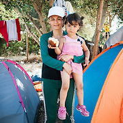 "Jeilan, 28 years old, from Aleppo, Syria, with her 4 years old daughter, stays in the Kara Tepe refugee camp on the island of Lesbos. She has already spent 5 days in the camp waiting for her papers to be issued by the police. ""I cannot believe that I am living in such conditions with my family,"" she says. ""I used to be a teacher back in my country. My husband was an accountant. Look at us now! This is inhumane."""
