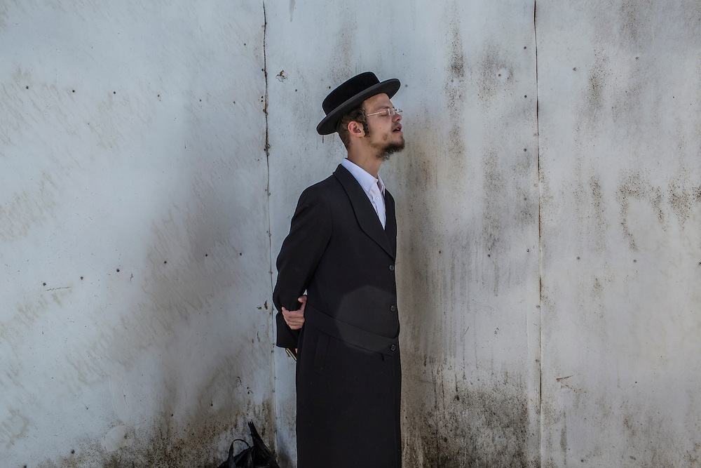UMAN, UKRAINE - SEPTEMBER 14: A Hasidic pilgrim prays near the burial site of Rebbe Nachman of Breslov on September 14, 2015 in Uman, Ukraine. Every year, tens of thousands of Hasidim gather for Rosh Hashanah in the city to pray at the holy site. (Photo by Brendan Hoffman/Getty Images) *** Local Caption ***