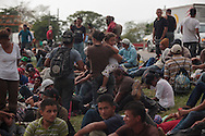Central American migrants have to make deadly, irregular and clandestine travels hidden in the wagons and gonads of the train through Mexico during weeks to arrive to the U.S.  The train is nicknamed &quot;La Bestia&quot; (The Beast) due to its dangerousness.<br /> <br /> Each Holly Week, along with Mexican human rights activists, make religious and protest activities during the &quot;Viacrucis del migrante&quot;. <br /> <br /> This year, they walk on foot, since the evening of Thursday April 17th, after the train where they travel, under Ferrocarriles del Istmo enterprise orders, unhooked the gonads with people and left them abandoned in Tenosique. After being left, they made the decision to continue their way on foot. <br /> <br /> They have traveled on foot more than 100 km (328 000 ft) from Tenosique, Tabasco demanding an end to the violence against migrants and free transit through Mexico. (Photo credit: Prometeo Lucero)
