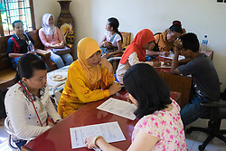 April 30, 2014 - Kendal, Indonesia. Aspiring domestic workers sign the contract to start their training in a centre in Kendal. © Thomas Cristofoletti / Ruom