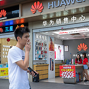 A shop selling photos and other gadgets, including Huawei, in Shenzhen, in a city known as a hightech hub in southern China.