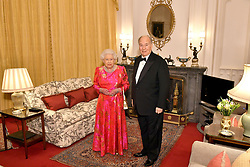The Queen Elizabeth II and the Aga Khan in the Oak Room at Windsor Castle before she hosts a private dinner in honour of the diamond jubilee of his leadership as Imam of the Shia Ismaili Muslim Community.