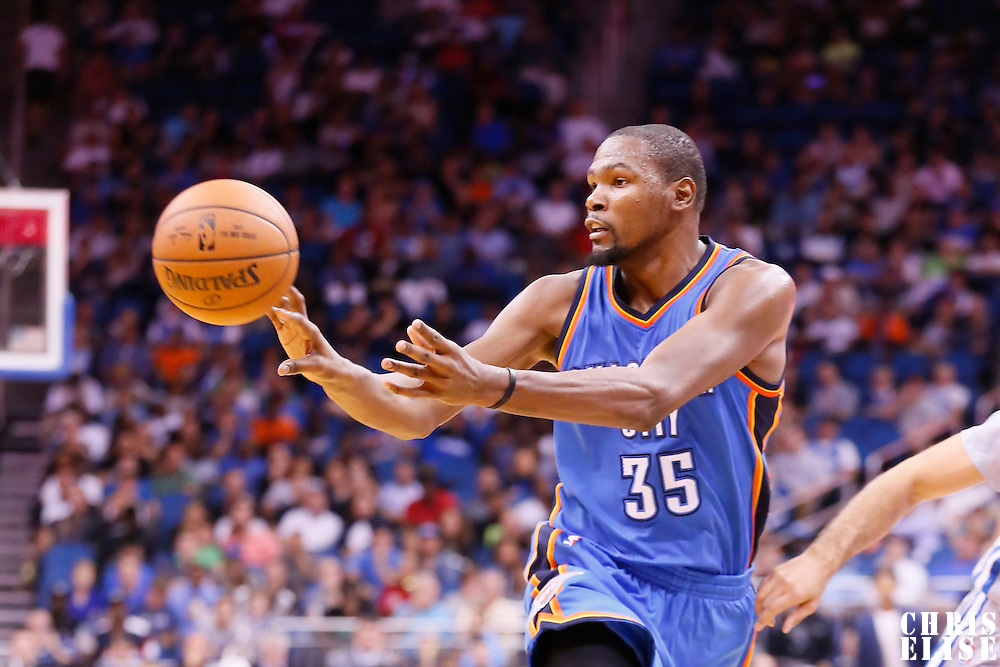 30 October 2015: Oklahoma City Thunder forward Kevin Durant (35) passes the ball during the Oklahoma City Thunder 139-136 double overtime victory over the Orlando Magic, at the Amway Center, in Orlando, Florida, USA.