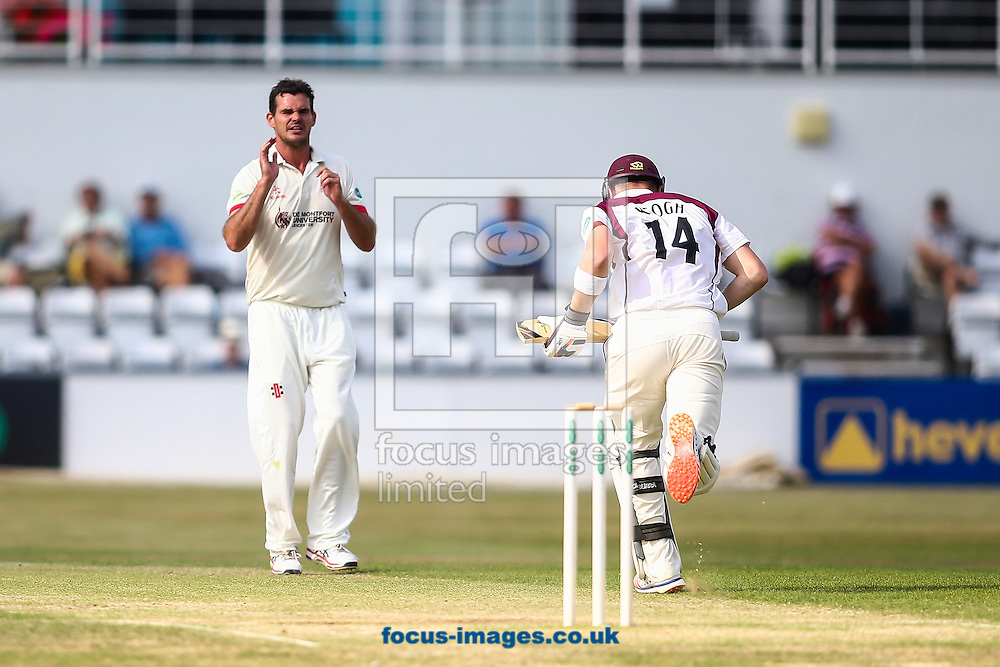 Clint McKay of Leicestershire (left) rues a near miss as Rob Keogh of Northamptonshire CCC (right)  takes a run during the Specsavers County C'ship Div Two match at the County Ground, Northampton<br /> Picture by Andy Kearns/Focus Images Ltd 0781 864 4264<br /> 14/08/2016