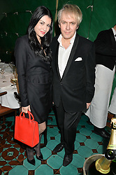 NICK RHODES and NEFER SUVIO at a dinner in honour of Christy Turlington hosted by Porter magazine at Mr Chow, Knightsbridge, London on 18th November 2014.
