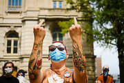 23 JULY 2020 - DES MOINES, IOWA:  A Black Lives Matter protester calls for the release of Viet Tran during a protest at the Polk County Criminal Court. About 75 members of Des Moines Black Lives Matter protested in support of Viet Tran, one of their members who was arrested by Des Moines Police on July 1. He was arrested on charges of disseminating classified or confidential police information because during an interview with a local TV station, he held a memo from the Des Moines Police Department naming individuals police wanted to arrest on vandalism charges. He got the memo from another Black Lives Matter protester. During today's bond hearing the court ruled that Tran should be released and subjected to electronic monitoring before the weekend.        PHOTO BY JACK KURTZ
