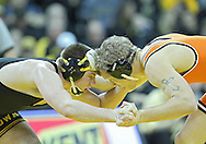 January 07, 2011: Iowa's Grant Gambrall and Oklahoma State's Blake Rosholt during the 197-pound bout in the NCAA wrestling dual between the Oklahoma State Cowboys and the Iowa Hawkeyes at Carver-Hawkeye Arena in Iowa City, Iowa on Saturday, January 7, 2012. Rosholt won 8-4.