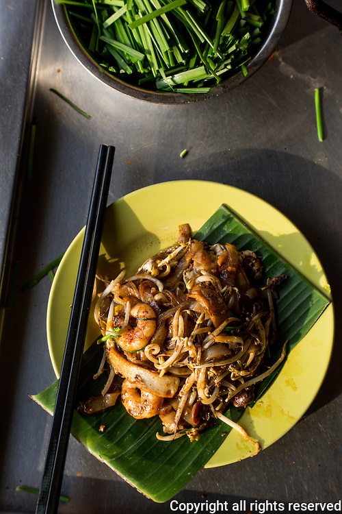 char koay teow, fried rice noodles with shrimp, fish cake, egg and bean sprouts. Air Itam, Penang, Malaysia