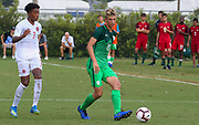 Slovenia midfielder Kristjan Trdiin (10) dribbles away from Canada midfielderJahkeele Stanford (7) during a CONCACAF boys under-15 championship soccer game, Saturday, August 10, 2019, in Bradenton, Fla. Slovenia defeated Canada in 2-1 in overtime and advanced to the finals against Portugal. (Kim Hukari/Image of Sport)