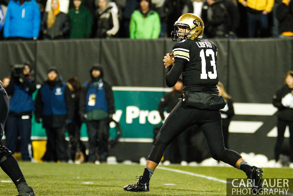 November 23rd, 2013:  Colorado Buffaloes freshman quarterback Sefo Liufau (13) drops back for a pass attempt in the first quarter of the NCAA Football game between the University of Southern California Trojans and the University of Colorado Buffaloes at Folsom Field in Boulder, Colorado